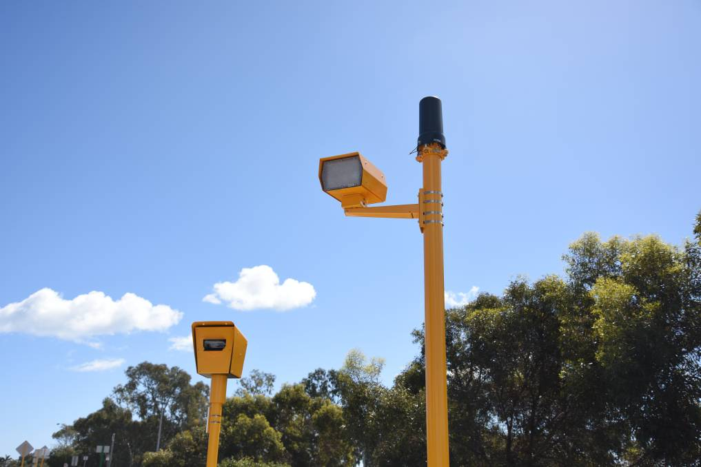 TWO YELLOW FIXED SPEEDING CAMERAS